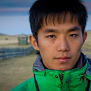 Portrait of young Japanese man in green jacket (Yu) (, Mongolia - Sep. 2008) (Image ID: 080909-1926351a)