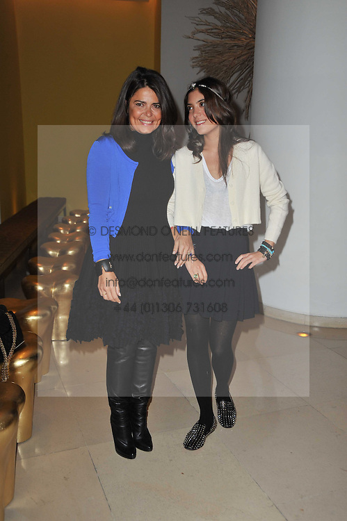 Left to right, Lebanese jewellery designer NOOR FARES and  DANIELA HELAYEL at a Burns Night dinner in aid of cancer charity CLIC Sargent held at St.Martin's Lane Hotel, London on 25th January 2011.