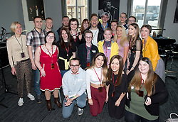 Olly Murs (centre) poses for a picture with patients for the Teenage Cancer Trust in a music workshop at the Royal Albert Hall, London.