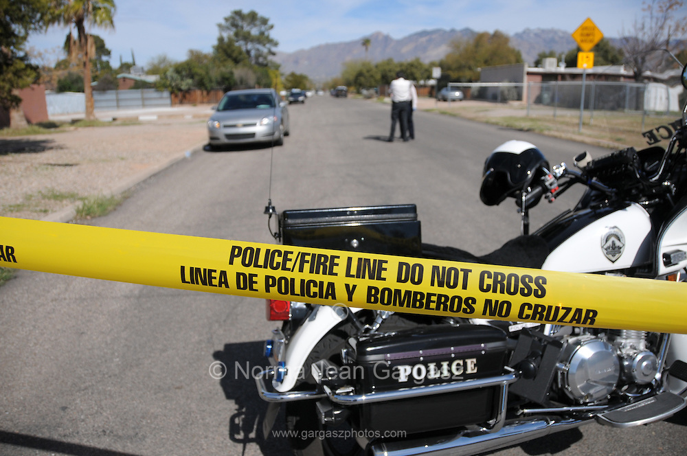 Tucson Police investigate a homicide and shooting of another man believed to be gang related in a midtown neighborhood in Tucson, Arizona, USA.