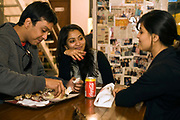 Young people eat in Khan Chacha a very fashionable but traditional kebab shop.<br /> Khan Market is a glitzy high end market frequented by the new Indian elite and foreigners. It is one of the most expensive retail streets anywhere in the world.