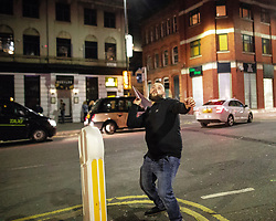 © Licensed to London News Pictures . 28/10/2018. Manchester, UK. A man throws a paper aeroplane in Stevenson Square in the Northern Quarter of Manchester City Centre . Revellers on a night out , many in fancy dress , on the weekend before Halloween . Photo credit: Joel Goodman/LNP
