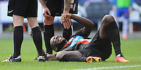 Blackpool's Ishmael Miller looks in pain after a challenge on Reading's Adam Federici (out of picture)<br /> <br /> Photographer Kevin Barnes/CameraSport<br /> <br /> Football - The Football League Sky Bet Championship - Reading v Blackpool - Saturday 25th October 2014 - Madejski Stadium - Reading <br /> <br /> © CameraSport - 43 Linden Ave. Countesthorpe. Leicester. England. LE8 5PG - Tel: +44 (0) 116 277 4147 - admin@camerasport.com - www.camerasport.com