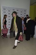 Bob Geldoff leaving the Talk pre-Bafta party with his Burberry gift bag. St. Martin's Lane Hotel. London. 24 February 2001. © Copyright Photograph by Dafydd Jones 66 Stockwell Park Rd. London SW9 0DA Tel 020 7733 0108 www.dafjones.com