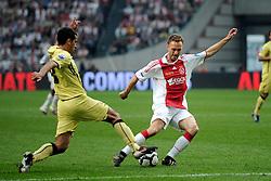 25-04-2010 VOETBAL: AJAX - FEYENOORD: AMSTERDAM<br /> De eerste wedstrijd in de bekerfinale is gewonnen door Ajax met 2-0 / Dennis Rommedahl en Giovanni van Bronckhorst<br /> ©2009-WWW.FOTOHOOGENDOORN.NL