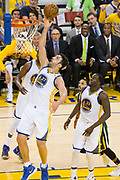 Golden State Warriors center Zaza Pachulia (27) takes the ball to the basket against the Utah Jazz during Game 1 of the Western Conference Semifinals at Oracle Arena in Oakland, Calif., on May 2, 2017. (Stan Olszewski/Special to S.F. Examiner)