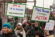 """Teachers were among the marchers. One bears a sign reading """"This Teacher demands action."""""""