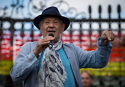Sir Ian McKellen unveils a rainbow love locks display to mark the 50th anniversary of the decriminalisation of homosexuality during the Greenwich + Docklands International Festival at the Old Royal Naval College in London.
