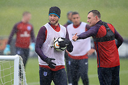 England's Eric Dier (left) and Phil Jones during the training session at St George's Park, Burton.