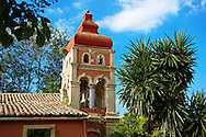 Greek Othodox church in the garden of the Palaia Anaktora [ ?????? ???????? ]  Corfu Greek Ionian Island .<br /> <br /> If you prefer to buy from our ALAMY PHOTO LIBRARY  Collection visit : https://www.alamy.com/portfolio/paul-williams-funkystock/corfugreece.html <br /> <br /> Visit our GREECE PHOTO COLLECTIONS for more photos to download or buy as wall art prints https://funkystock.photoshelter.com/gallery-collection/Pictures-Images-of-Greece-Photos-of-Greek-Historic-Landmark-Sites/C0000w6e8OkknEb8