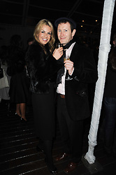 NICK MORAN and VICTORIA LEWIS at a party following a private view of photographs by Lorraine Goddard entitled 'Out of Context' held at the Sanderson Hotel, Berners Street, London on 21st January 2010.