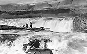 9305-B7345. view of Indians fishing at Celilo Falls. ca, 1928