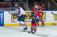 KELOWNA, CANADA - OCTOBER 27: Brothers Jordan Topping #12 of the Tri-City Americans and Kyle Topping #24 of the Kelowna Rockets skates up the ice on October 27, 2017 at Prospera Place in Kelowna, British Columbia, Canada.  (Photo by Marissa Baecker/Shoot the Breeze)  *** Local Caption ***