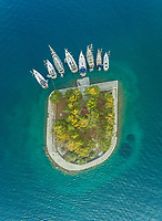 Aerial view of group of boats anchored on Lazareto island, Greece.
