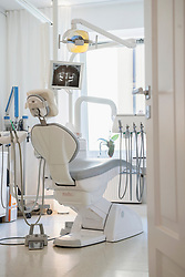 Dentist's chair facing screen with x-ray, Munich, Bavaria, Germany