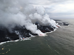 June 14, 2018 - Hawaii, U.S. - Several laze plumes rise along the ocean entry margin as break outs feed many small and large flows. The largest Pahoehoe breakout area is on the northern margin of the flow (furthest plume in this image) (Credit Image: © USGS/ZUMA Wire/ZUMAPRESS.com)