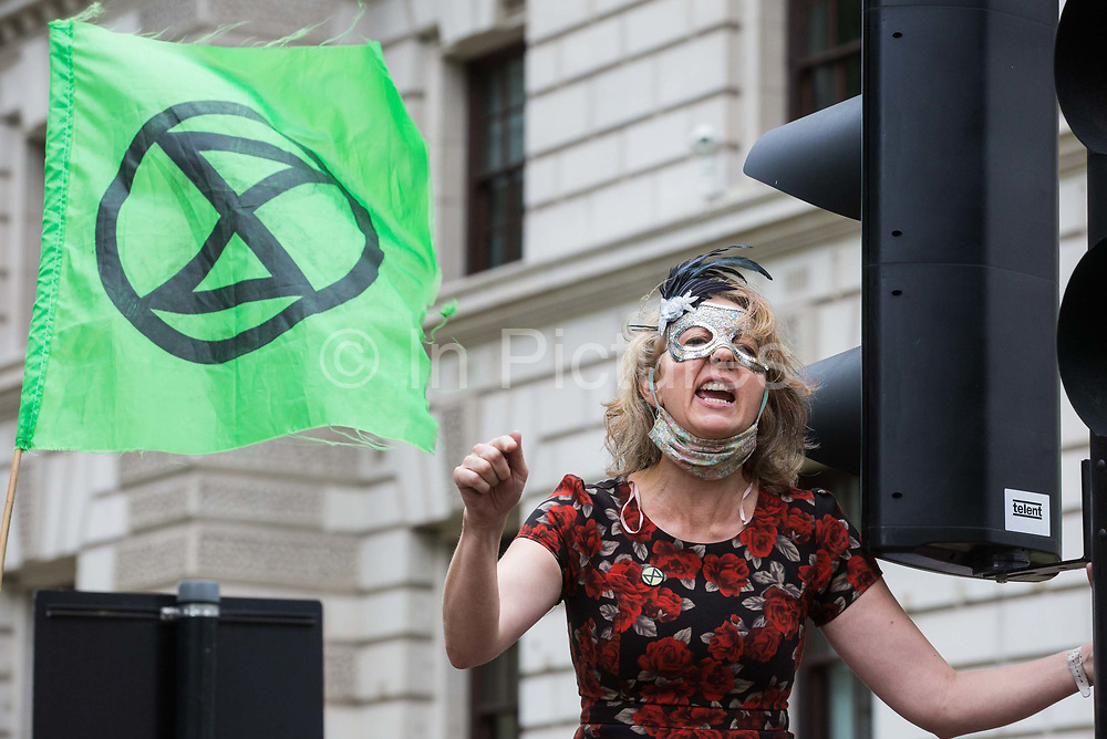 Dr Gail Bradbrook, co-founder of Extinction Rebellion, addresses fellow climate activists at a 'Carnival of Corruption' protest outside the Treasury against the government's facilitation and funding of the fossil fuel industry on 3 September 2020 in London, United Kingdom. Extinction Rebellion activists are attending a series of September Rebellion protests around the UK to call on politicians to back the Climate and Ecological Emergency Bill CEE Bill which requires, among other measures, a serious plan to deal with the UK's share of emissions and to halt critical rises in global temperatures and for ordinary people to be involved in future environmental planning by means of a Citizens' Assembly.