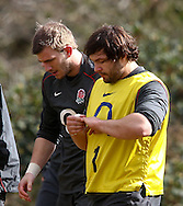 Alex Corbisiero (R) tends to a hurt little finger during the England elite player squad trainnig session at Pennyhill Park, Bagshot, UK, on 11th March 2011  (Photo by Andrew Tobin/SLIK images)