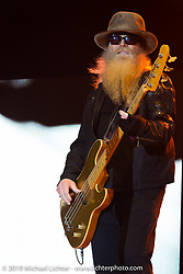 Dusty Hill of ZZ Top plays on the Wolfman Jack stage at the Buffalo Chip Campground during the annual Sturgis Black Hills Motorcycle Rally. SD, USA. August 6, 2014.  Photography ©2014 Michael