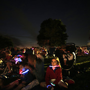 Spectators watch the 35th Annual Family Fourth of July Fireworks Celebration at Waveny Park, New Canaan, Connecticut, USA. 4th July 2015. Photo Tim Clayton