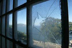 A broken window at the former prison on Alcatraz Island, San Francisco Bay, California, USA , taken in September 2004..©Pic : Michael Schofield.