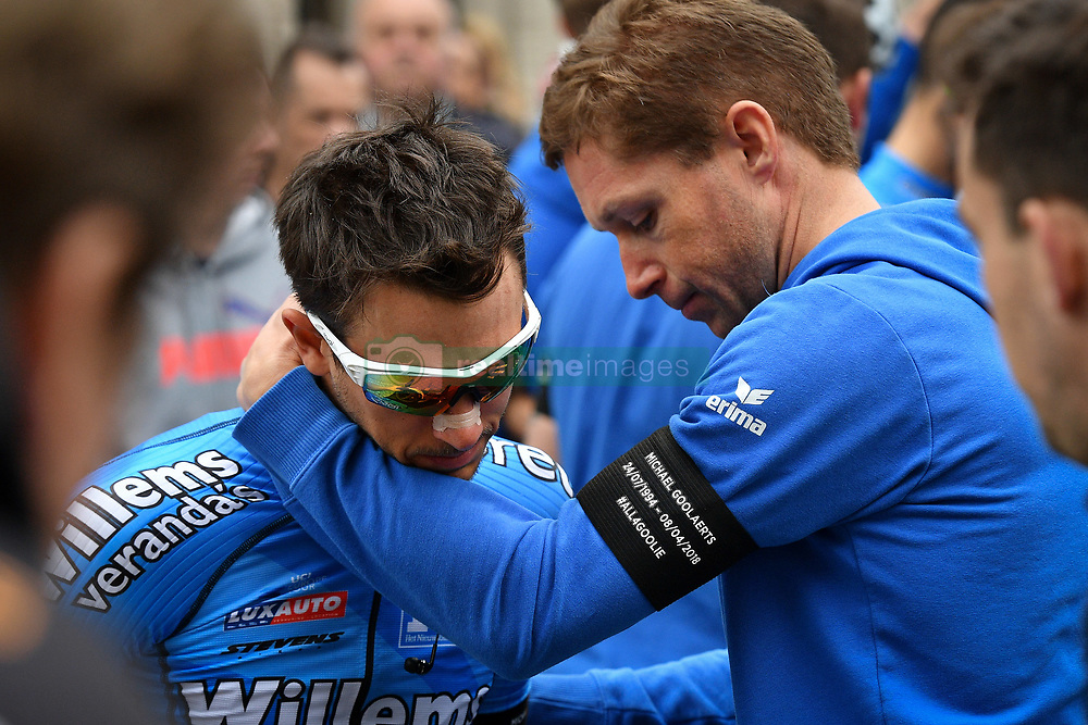April 11, 2018 - Leuven, BELGIUM - Belgian Dries De Bondt of Verandas Willems - Crelan and Belgian Stijn Devolder of Verandas Willems - Crelan pictured at a minute of silence as a tribute to the 23 year old cyclist Michael Goolaerts who died after a crash in the Paris-Roubaix race on Sunday 8 April, at the start of the 58th edition of the 'Brabantse Pijl' one day cycling race, 201,9 km from Heverlee, Leuven to Overijse, Wednesday 11 April 2018. BELGA PHOTO DAVID STOCKMAN (Credit Image: © David Stockman/Belga via ZUMA Press)