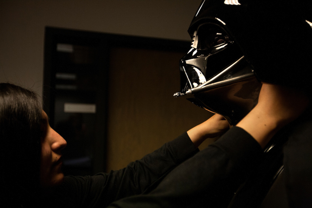 Dahlia Penland, left, straightens the helmet on her husband Jonathan Penland (Darth Vader) as the 501st Legion Central Garrison prepares to mingle with the crowd during Star Wars night at the Timberwolves game at Target Center in Minneapolis December 15, 2015.