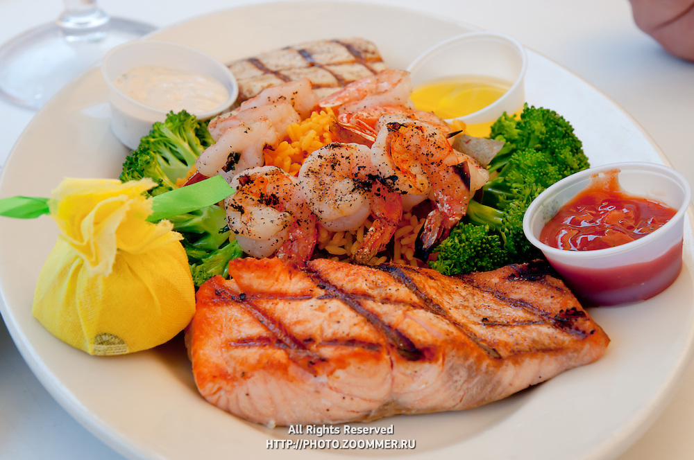 Seafood plate with tilapia grill fish, shrimps, rice and veggies