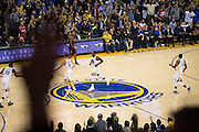 The Golden State Warriors celebrate a dunk by Golden State Warriors forward Draymond Green (23) late in the fourth quarter against the Houston Rockets at Oracle Arena in Oakland, Calif., on December 1, 2016. (Stan Olszewski/Special to S.F. Examiner)