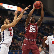 Quenton DeCosey, (right), Temple, shoots over Cannen Cunningham, (left) and Sterling Brown, SMU, during the Temple Vs SMU Semi Final game at the American Athletic Conference Men's College Basketball Championships 2015 at the XL Center, Hartford, Connecticut, USA. 14th March 2015. Photo Tim Clayton