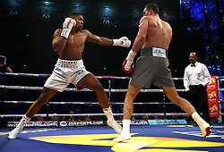 Anthony Joshua (left) in action against Wladimir Klitschko during their IBF, WBA and IBO Heavyweight World Title bout at Wembley Stadium, London.