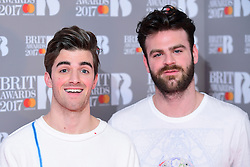 Drew Taggart and Alex Pall (right) of The Chainsmokers in the press room during the Brit Awards at the O2 Arena, London. PRESS ASSOCIATION Photo. Picture date: Wednesday February 22, 2017. See PA story SHOWBIZ Brits. Photo credit should read: Ian West/PA Wire. Editorial Use Only - No Merchandising