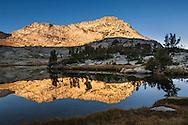 Morning light on Vogelsang Peak reflected in Vogelsang Lake, Yosemite National Park, California