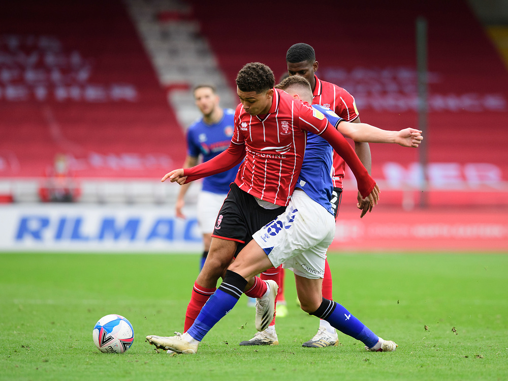 Lincoln City's Brennan Johnson vies for possession with Charlton Athletic's Alfie Doughty<br /> <br /> Photographer Chris Vaughan/CameraSport<br /> <br /> The EFL Sky Bet League One - Lincoln City v Charlton Athletic - Sunday 27th September, 2020 - LNER Stadium - Lincoln<br /> <br /> World Copyright © 2020 CameraSport. All rights reserved. 43 Linden Ave. Countesthorpe. Leicester. England. LE8 5PG - Tel: +44 (0) 116 277 4147 - admin@camerasport.com - www.camerasport.com