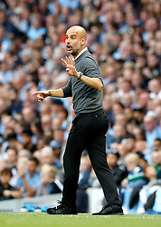 """Manchester City manager Pep Guardiola gestures during the Premier League match at the Etihad Stadium, Manchester. PRESS ASSOCIATION Photo. Picture date: Saturday September 1, 2018. See PA story SOCCER Man City. Photo credit should read: Martin Rickett/PA Wire. RESTRICTIONS: EDITORIAL USE ONLY No use with unauthorised audio, video, data, fixture lists, club/league logos or """"live"""" services. Online in-match use limited to 120 images, no video emulation. No use in betting, games or single club/league/player publications."""