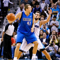 November 17, 2010; New Orleans, LA, USA; Dallas Mavericks power forward Dirk Nowitzki (41) of Germany is guarded by New Orleans Hornets shooting guard Marco Belinelli (8) of Italy during a game at the New Orleans Arena. The Hornets defeated the Mavericks 99-97. Mandatory Credit: Derick E. Hingle