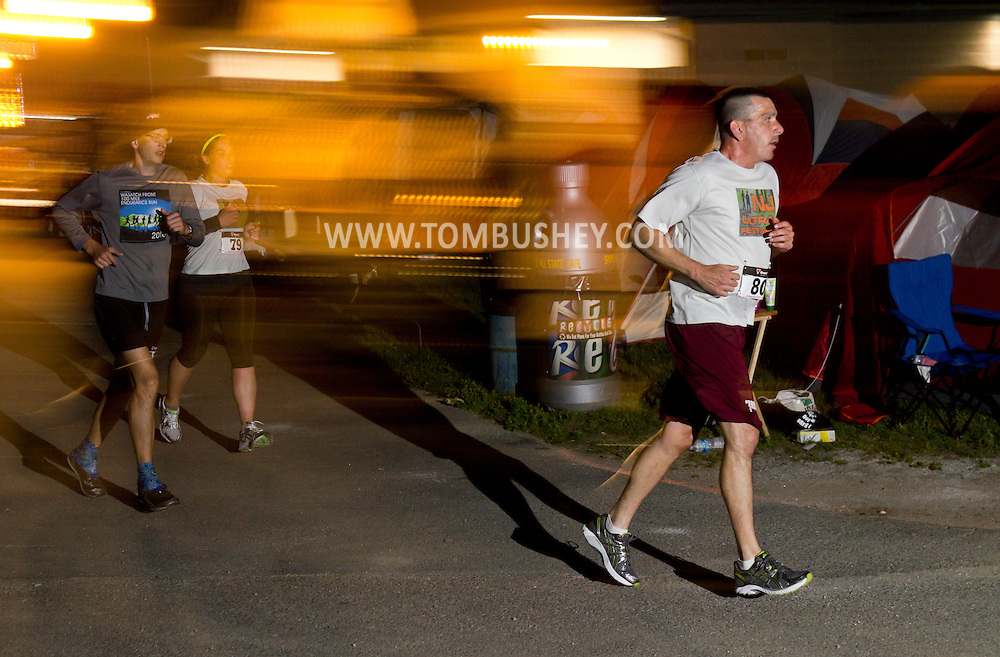 Augusta, New Jersey - Runners on the course at night during the 3 Days at the Fair races at Sussex County Fairgrounds on May 12, 2012.