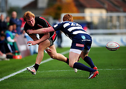 Ulster Ravens' Rory Scholes passes the ball through his legs to deceive Bristol Rugby's Jack Tovey - Photo mandatory by-line: Dougie Allward/JMP  - Tel: Mobile:07966 386802 21/10/2012 - SPORT - Rugby Union - British and Irish Cup -  Bristol  - The Memorial Stadium - Bristol Rugby V Ulster Ravens