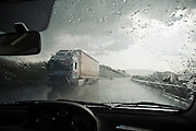 Driving through a rainstorm on a highway through Extremadura, Spain.
