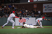 San Francisco Giants shortstop Brandon Crawford (35) slides into second base late in the game against the Cincinnati Reds at AT&T Park in San Francisco, California, on May 11, 2017. (Stan Olszewski/Special to S.F. Examiner)