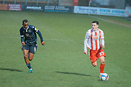 Stevenage forward Jack Aitchison (27) travels with the ball as Morecambe Forward Carlos Mendes Gomes (11) chases after him to win it back during the EFL Sky Bet League 2 match between Stevenage and Morecambe at the Lamex Stadium, Stevenage, England on 6 February 2021.