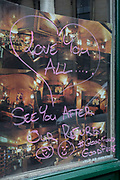 Detail of handwritten messages in the window of a Covent Garden restaurant called Le Garrick, temporarily closed for a refurbishment, on 22nd February 2017, on Garrick Street, in London England.