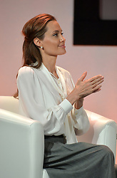 Image ©Licensed to i-Images Picture Agency. 11/06/2014.<br /> <br /> Angelina Jolie applauds William Hague after speaking at the Global Summit to End Sexual Violence in Conflict at The ExCel, London, UK.<br /> <br /> Picture by Ben Stevens / i-Images
