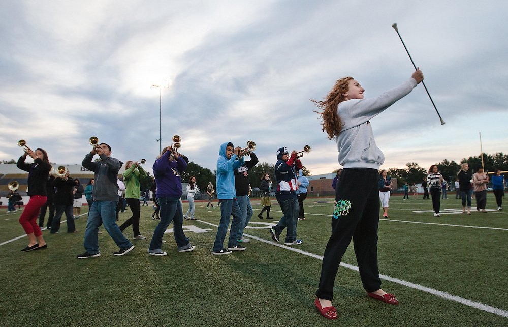 Freshman baton twirler Payton Best performs with the rest of the marching band during practice Monday morning at Grand Island Senior High. Senior High will be defending it's Class AA parade performance, superior rating in field contest, and best overall performance titles at Harvest of Harmony in less than a week. (Independent/Matt Dixon)