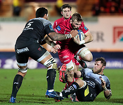 Scarlets' John Barclay under pressure from Toulon's Romain Taofifenua<br /> <br /> Photographer Simon King/Replay Images<br /> <br /> European Rugby Champions Cup Round 6 - Scarlets v Toulon - Saturday 20th January 2018 - Parc Y Scarlets - Llanelli<br /> <br /> World Copyright © Replay Images . All rights reserved. info@replayimages.co.uk - http://replayimages.co.uk