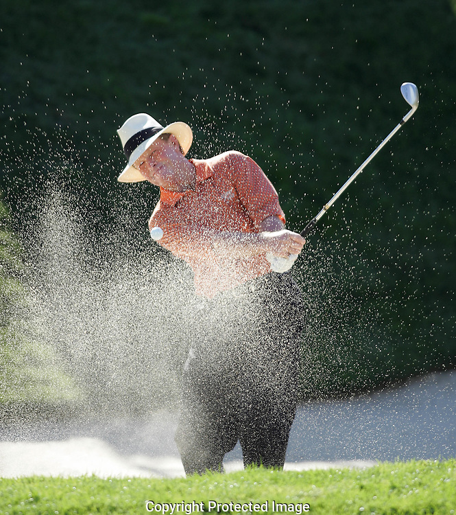 Tom Kite hits out of a sand trap during a playoff on the 18th hole the final round of the Champions Tour's Boeing Greater Seattle Classic golf tournament in Snoqualmie, Wash. (AP Photo/John Froschauer)