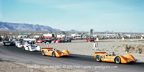"""Denny Hulme (5) and Bruce Mclaren (4), aka """"The Bruce and Denny Show,"""" in their McLaren M6-Chevrolets lead the opening lap of the 1967 Can-Am at Stardust Raceway, Las Vegas, Nevada, USA. Third is Jim Hall (66, Chaparral 2G). Others include Peter Revson, Dan Gurney, Mark Donohue, Chris Amon and ultimate race winner John Surtees."""