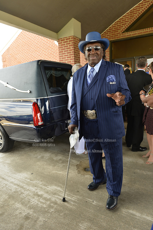 """5/30/15 Indianola  Harmonica player  Big George Brock arrives to see his friend B B King's funeral service.  """"See That My Grave Is Kept Clean"""" one of BB Kings famous songs forecast his funeral procession complete with two white horses and a black horse flanked with two signed Gibson guitars. Fans lined the street to see B.B. Kings final homecoming and pay their respect. Photo ©Suzi Altman"""