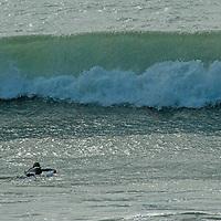 Surfers ride waves near Half Moon Bay, California.