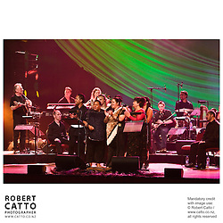 Led by D?nal Lunny, known internationally as the foremost catalyst for the renaissance of traditional Irish music, this ensemble is a unique collaboration honouring ancient Celtic and Maori music in a contemporary context...Lunny has assembled the leading lights of the traditional musical circles from Ireland and Aotearoa to meet, workshop and collaborate in New Zealand before joining the Festival to bring us this cutting edge show woven from strands of music, kapa haka dance, poetry, the NZ traditional instruments Taonga Puoro or 'singing treasures' and the age-old gaelic style of singing Sean Nos...Featuring NZ's vocalist Whirimako Black, Taongo Puoro master Richard Nunns joined by Horomona Horo, percussionist Riki Gooch (founding member of Trinity Roots) and multiple award winning Glenn Colquhoun, voted 'The Peoples Poet' in the Montana Awards...From Ireland, joining Donal Lunny is fiddler Nollaig Casey, singer Iarla O' Lionaird, harpist Laois.e Kelly, guitarist Steve Cooney, Uilleann piper Sean McKeon and Irish poet Cathal O Searcaigh.